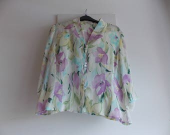 A Ladies Silk blouse. Floral pattern.