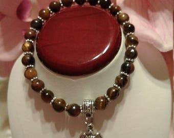 Tiger Eye Glass Beaded Bracelet Accented with a Turtle Charm