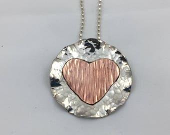 Mixed metal heart pendant