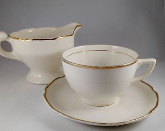 Cup, Saucer and Creamer, marked USA