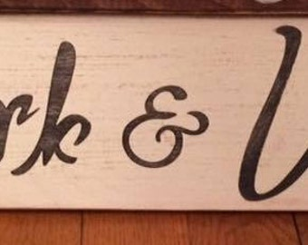 "Hand-painted, wood sign, ""Uncork & Unwind."""