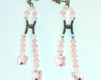 Swarovski crystal earrings Crystal Beads and Swarovski butterfly rose.  925 Silver hardware.