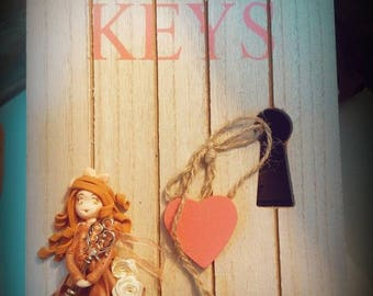 Wooden key box and her doll in cold porcelain