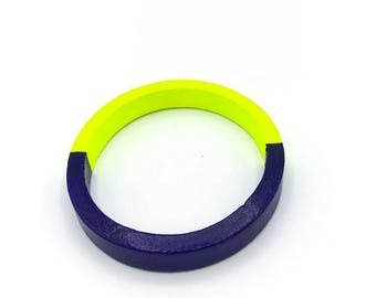 Handmade  bright geometric wooden bangle in neon yellow and royal blue