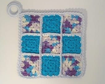 Pot holder, blue, purple and sky in grannies crochet