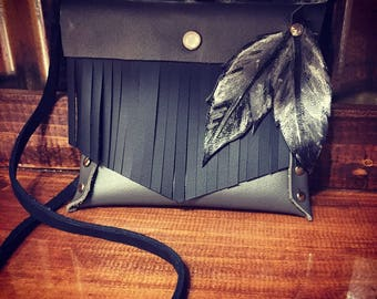 Handmade leather feather, and fringe clutch