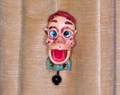 """See """"BILLY"""" the amazing 3 inch Pin Head, Ventriloquist's novelty pin."""