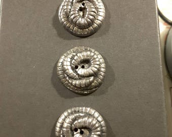 Vintage set of 3 coiled worm buttons.