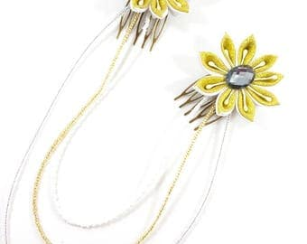 Pair of gold and white kanzashi flower combs and its strings of seed beads. Ideal wedding or prom