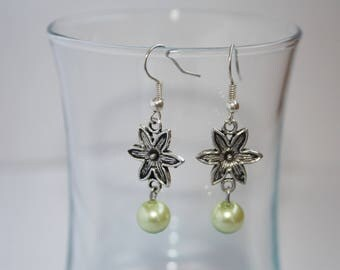 Pair of flower and green pearl earrings