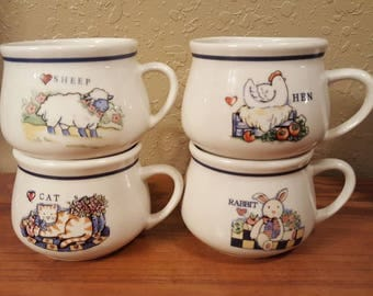 Vintage 1980's soup mugs.  Set of 4 blue and white animal mugs.  Cat, Hen, Sheep and Rabbit soup mugs.