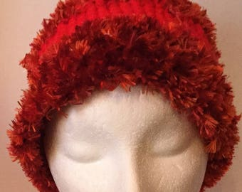 Rust and bright red, cozy furry hat