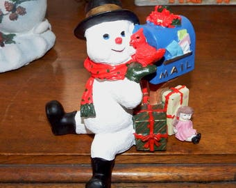 Snowman on a Ledge Figurine