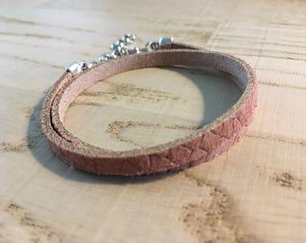 Pink leather bracelet with snake pattern