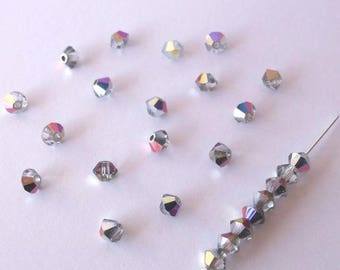 25 bicones 4 mm Crystal Swarovski - Crystal and silver reflections pink and purple