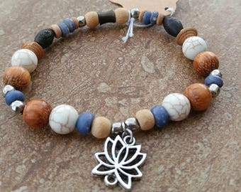 BOHO stretch bracelet with various wood beads and lotus flower silver charm