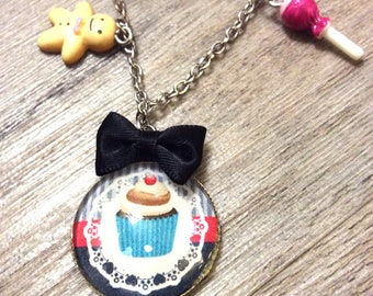 """Gourmet necklace with cabochon """"cup cake"""" resin with bow and gingerbread and candy decorations"""