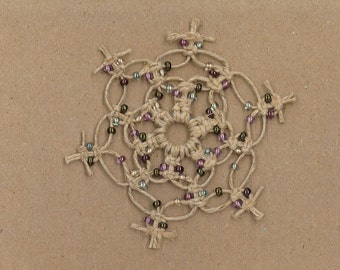 Handmade natural hemp snowflake with multi-colored glass beads by TwistedandKnottyUS