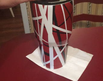 red, white, and black tumbler