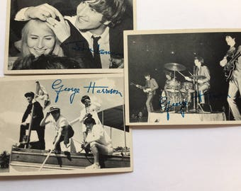 Three Beatles collectors' cards #85, 87, 111 in black and white
