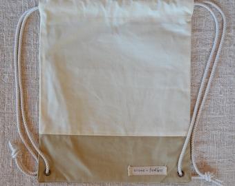 Beige canvas drawstring backpack