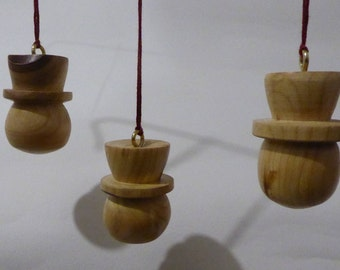 3 hand turned cherry wood christmas decorations