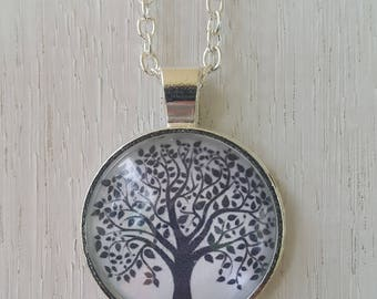 Tree of life cabochon glass pendant on silver necklace