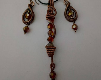 set of pendant and earrings