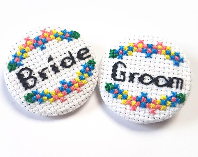 Featured listing image: Bride Groom Pins-Set of Two-Bridal Badge-Same Sex Couple-Wedding Accessory-Bridal Party Gifts-Floral Pins-Cross Stitch Pin-Offbeat Bride Fan