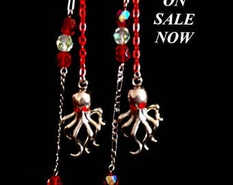 Octopus with Red Rhinestone Eyes Extra long Red Chain Dangles and sterling chain