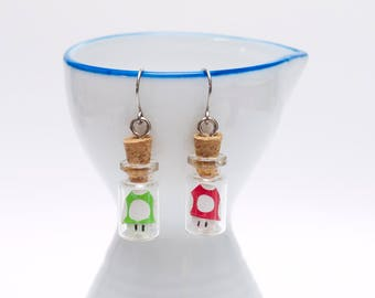 Origami Mario Bros shroom earrings in tiny glass bottle