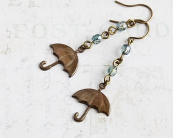 Antiqued Brass Umbrella Dangle Earrings with Light Blue Glass Beads