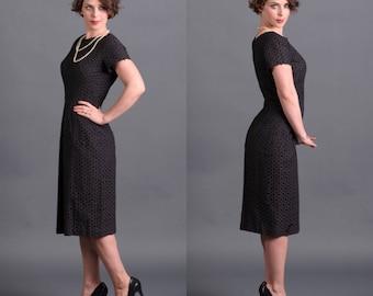 Vintage 1960s black sheath dress, knee-length LBD, with cutwork eyelet overlay, S/M