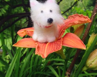 Miniature westie figurine wearing a red collar