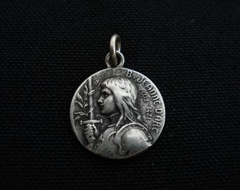 Religious antique French silvered catholic medal pendant medallion of Saint Jeanne d'Arc Joan of Arc with sword. ( 6 )
