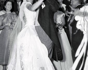 Jacqueline Bouvier Kennedy dances with her new father-in-law, Joseph P. Kennedy