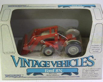 Vintage NOS   Ertl Vintage Vehicle series Ford 8 N Tractor with front end loader 1 :43 scale die cast Model