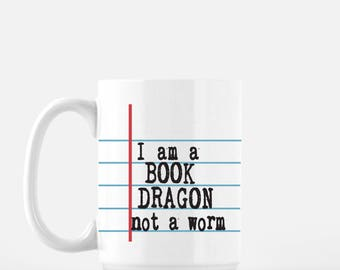 I am a Book Dragon not a worm. Notebook Paper Graphic© Ceramic Mug.  Back to school fun! Unique teacher and student gift.