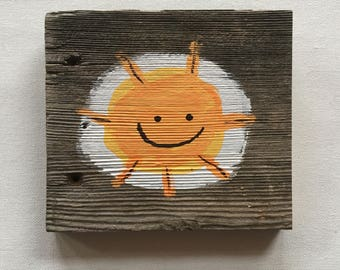 sunshine hand painted on reclaimed wood
