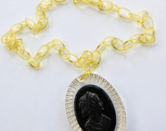 Black Cameo on Carved Lucite with Celluloid Chain