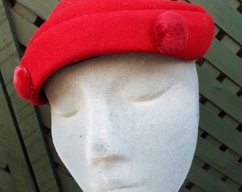 Vintage Ladies Hat 1950's Red Wool Asymmetric dress hat with Red Velvet Button design by Henry Pollak