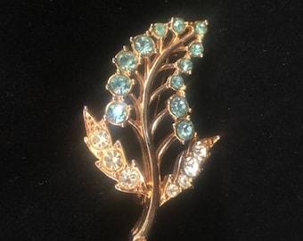 Vintage: Gold leaf brooch with diamante details.