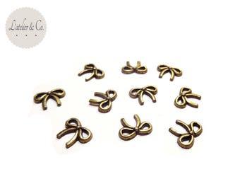Set of 50 Mini bow 10x9mm metal connectors bronze Rreloque [L22]