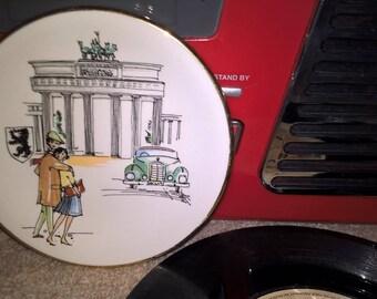 Brandenburg Gate Berlin, Mid century souvenir keys / trinket dish with sketch like figures of young man, woman, car, the gate, Berlin crest