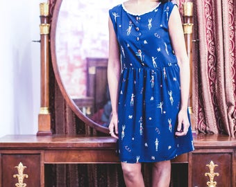Super Sale! original price 80, now 50. Smock dress in viscose with dancers and gymnasts, buttons and lace collar.