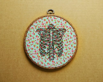 Ribcage Tattoo Hand Embroidery Hoop Art - floral fabric (modern hand embroidery wall hanging - skeleton embroidery)
