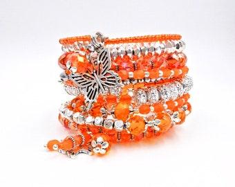 Orange beaded bracelet, memory wire bracelet, orange wrap bracelet, butterfly bracelet, charm bracelet, crystal bracelet