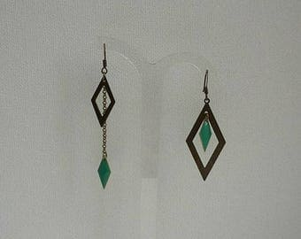 asymmetric earrings bronze with green diamond pendants and chains