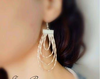 Elegant long drop earrings