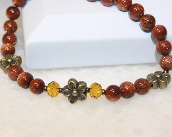 Red Goldstone Stretch Beaded Bracelet with Flower Beads. Goldstone Jewellery. Handmade Bracelet. Aventurine Glass Bracelet. Free Delivery.